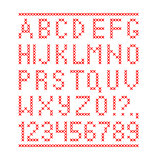 Embroided by cross stitch english alphabet with numbers and symbols isolated on white background.