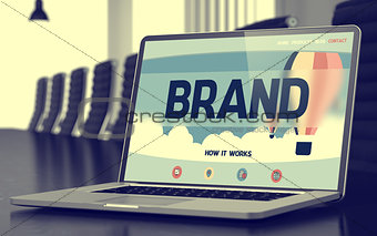 Brand on Laptop in Conference Hall. 3D.