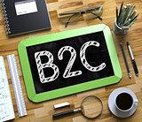 B2C - Text on Small Chalkboard. 3D.