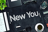 New You on Black Chalkboard. 3D Rendering.