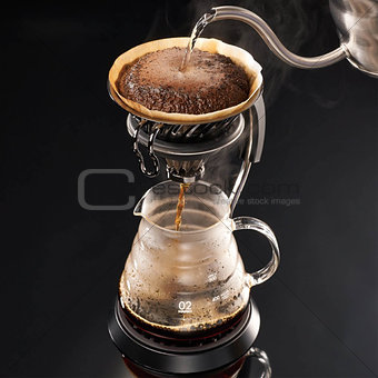 Brewing coffee with black background, close up