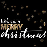 Merry Christmas gold and white lettering design on black background with golden snowflakes.