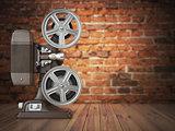 Vintage projector on the bricks background. Cinema, movie or vid