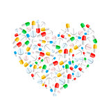 Colourful pills in heart shape isolated on white