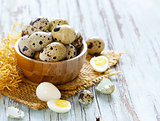 natural organic quail eggs on a wooden table