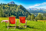 deck chairs and table on the meadow