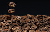 heap of coffee beans falling