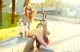 Happy Hipster Girl with her Pet in Summer Park