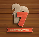 Happy new year 2017 design on wood background.