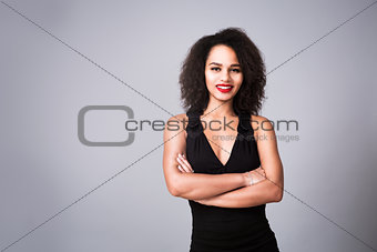 Portrait of Happy Woman in Black Dress on Gray