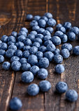 Blueberries on grunge wooden kitchen board