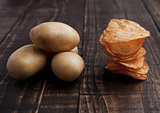 Fresh potatoes and crisps healthy and junk food