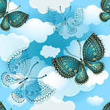 Seamless spring pattern with butterflies and clouds