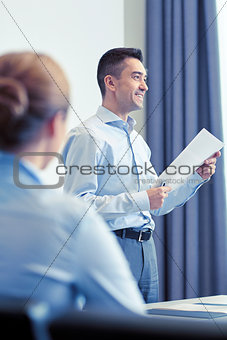 smiling businesspeople meeting in office