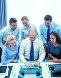 smiling business people with laptop in office