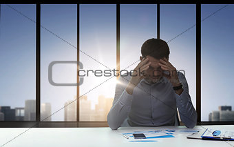 close up of anxious businessman with papers