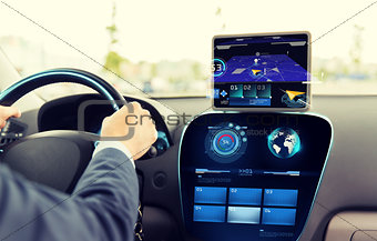close up of man driving car with navigation system
