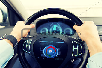 close up of man driving car with volume level icon