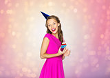 happy woman or teen girl with birthday cupcake