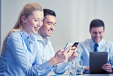 businesspeople with smartphones and tablet pc