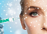 close up of woman face and syringe over snow