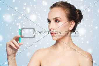 beautiful woman holding syringe with injection