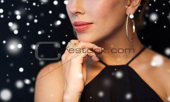 close up of beautiful woman with diamond jewelry