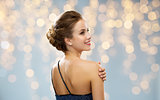 woman in evening dress from back over lights