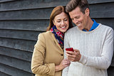 Happy Middle Aged Man Woman Couple Using Cell Mobile Phone