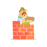 Builder Laying A Brick Wall On Construction Site