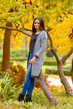 portrait of pretty teen girl in autumn park