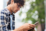 close up of man with tablet pc outdoors