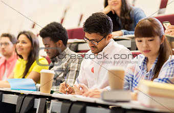 group of students with coffee writing on lecture