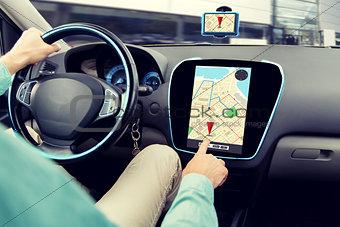 close up of man driving car and using navigator