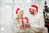 happy couple at home with christmas gift box