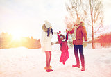 happy family in winter clothes walking outdoors