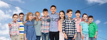 group of happy smiling children hugging