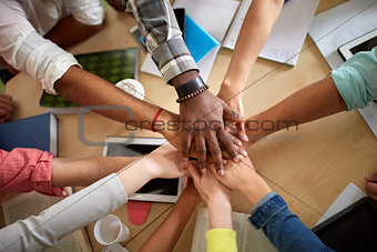 close up of international students hands on top