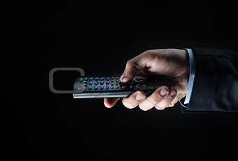 close up of businessman hand with remote control