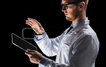 close up of doctor or scientist with tablet pc