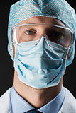 close up of scientist in goggles, mask and hat