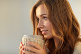 close up of happy woman with tea or coffee cup