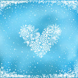 snow heart on blue background