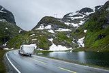 Camper traveling at scenic norwegian road in the mountains.