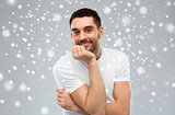smiling man over snow background