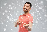 man pointing finger to you over snow background