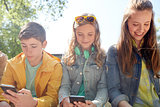 teenage friends with smartphone and headphones