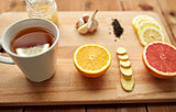 ginger tea with honey, citrus and garlic on wood