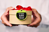 man with a gift box with the text black friday