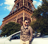 happy man near cabriolet car over eiffel tower
